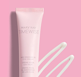 A picture of a small pink tube and a smear of TimeWise® Age Minimize 3D® Eye Cream
