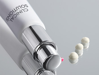 Photo of Clinical Solutions™ Retinol 0.5 on mirror with three pea-sized drops of the formula.
