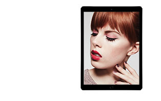 Try on a new holiday look using the Mary Kay Virtual Makeover. A red head young woman is shown in a tablet on the right side. She is wearing pink eye shadow and red lipstick.